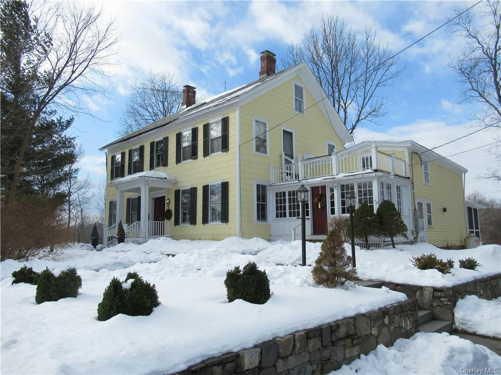 Charming Greek Revival Center Hall Colonial